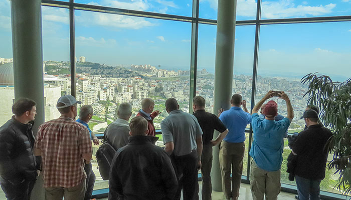 a group of asti trainees overlooking israel from a vantage point.